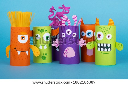 colorful monsters made out of toilet paper on a blue background. handmade work. the concept of reuse Сток-фото ©