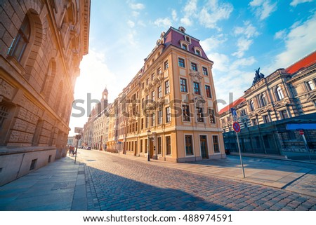Colorful morning scene in Dresden. Sunny cityscape in capital of Saxony with Baroque church Frauenkirche cathedral in the background, Germany, Europe. Artistic style post processed photo.