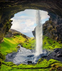 Colorful morning view from the middle of Kvernufoss waterfall. Majestic scene in south Iceland, Europe. Artistic style post processed photo.
