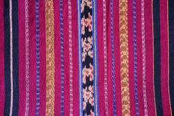 Colorful motif of traditional hand loom fabric with ethnic pattern namely Tenun Ikat Sikka from Flores Island Indonesia. Seamless pattern woven made with natural dyes process.