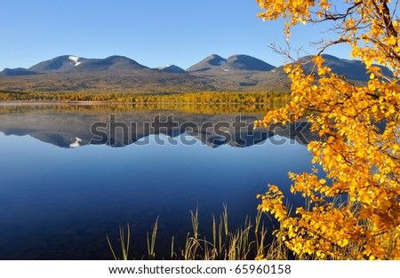 Colorful mountain in Abisko national-park and reflection from mountain in the lake