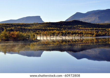 Colorful mountain in Abisko national-park in Sweden and reflection from the mountain in the lake