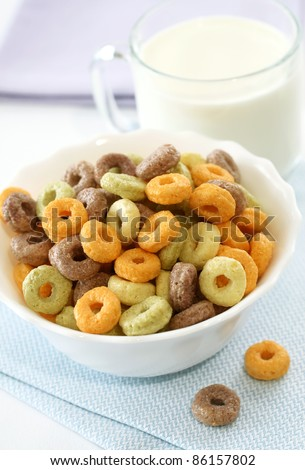 colorful muesli in bowl and milk in glass