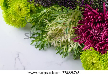 Colorful mums on marble background.  Mums symbolize optimism and joy.  13th wedding anniversary flower.   #778228768
