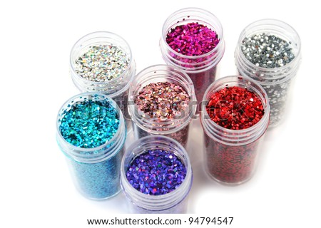 Colorful nail glitters isolated on white background.