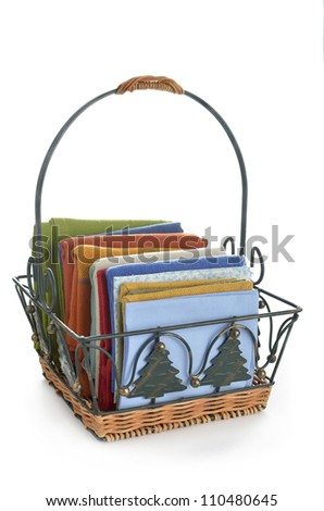Colorful napkins in decorative basket