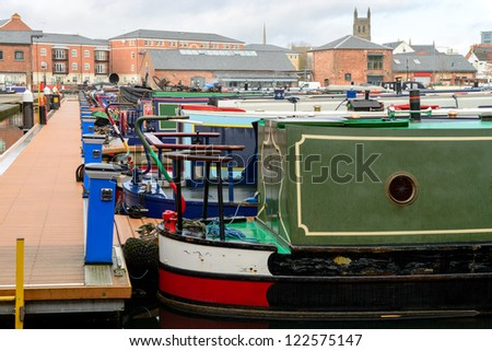Colorful narrow boat sterns