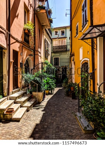 Colorful narrow street in Italy #1157496673