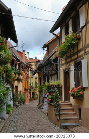 Colorful narrow street with beautiful half-timbered houses - stock photo
