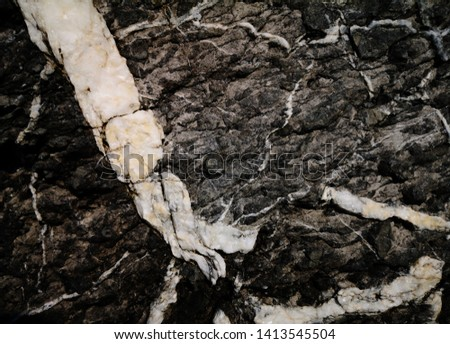 Colorful natural stone background texture/Stone texture background/Close up of a stone texture background/Details of sand stone texture/The detail texture of stone