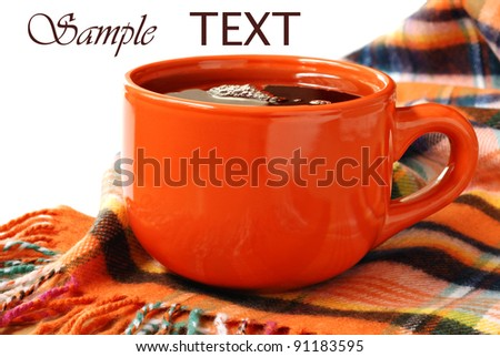 Colorful neck scarf with cup of hot tea or coffee on white background with copy space.  Conceptual image for comfort and warmth during cold season.