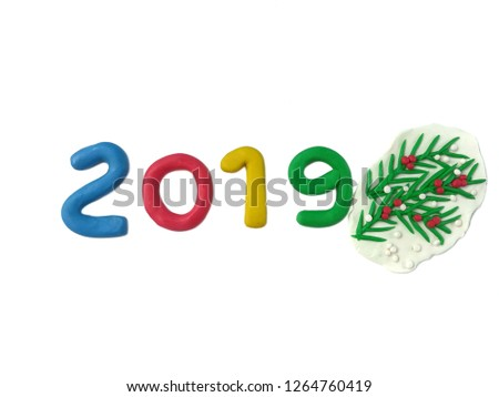 Colorful 2019 new year text and leaves made from plasticine clayare placed on white background, beautiful dough decorate are festival