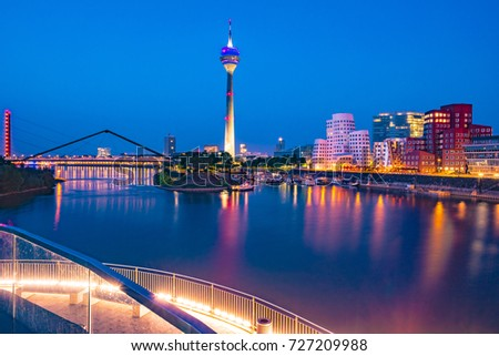Colorful night scene of Rhein river at night in Dusseldorf. Media Harbor in the soft night light, Nordrhein-Westfalen, Germany, Europe #727209988