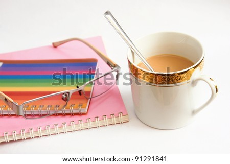 Colorful notebook glasses and coffee cup