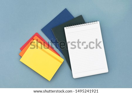 Colorful notepads on the blue background.