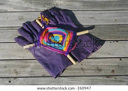 Colorful Object on Purple Gloves on Pier