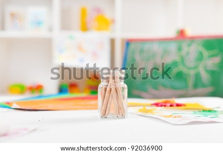 Colorful objects on a preschool art table