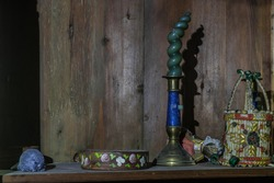 colorful objects on a wooden box in an old mill