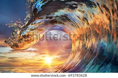 Stock Photo Colorful Ocean Wave. Sea water in crest shape. Sunset light and beautiful clouds on background