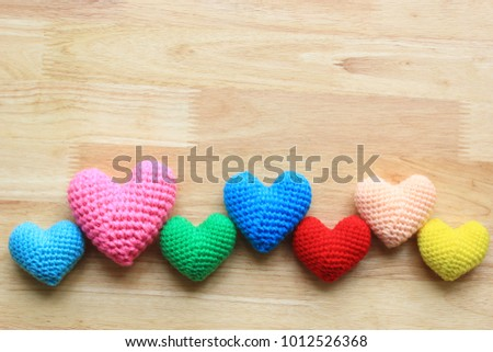 Colorful of Handmade crochet heart on wood background for valentines day