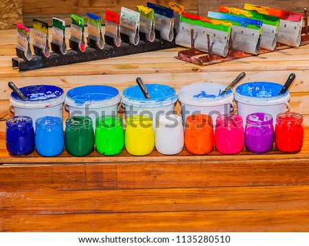 colorful of ink for print tee shirt in store of tee shirt factory. Plastisol ink useful in tee shirt factory and in industry for export with copy space.