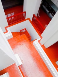 colorful of red orange building . white pillar around stair.porch corner on step layer.come down walk way as still