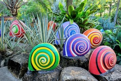 Colorful of sculpture snails in beautiful garden.