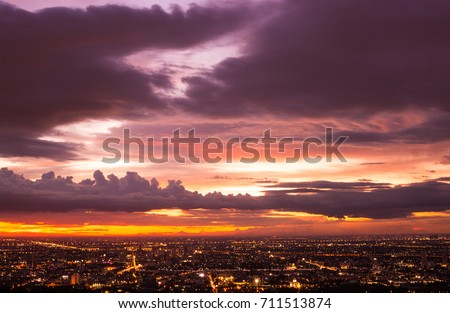 Colorful of sky and cloud in sunset,and twilight,with cityscape in the evening  #711513874