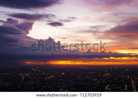 Colorful of sky and cloud in sunset,and twilight,with cityscape in the evening  #712703929