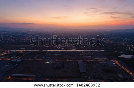 Colorful of sky and cloud in sunset and twilight, with cityscape in the evening. Cityscape Aerial View.