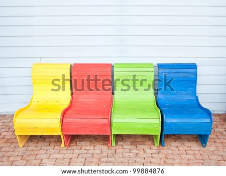 Colorful of vintage chair on wood wall
