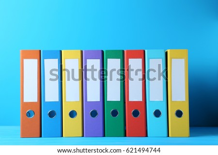 Colorful office folders on blue background #621494744
