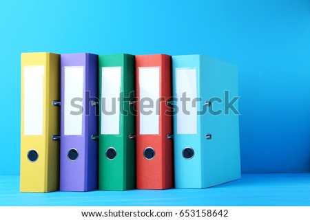 Colorful office folders on blue background #653158642