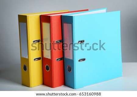 Colorful office folders on grey background
