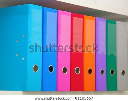 Colorful office folders on the bookshelf