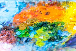 Colorful oil paints on tray for painting.