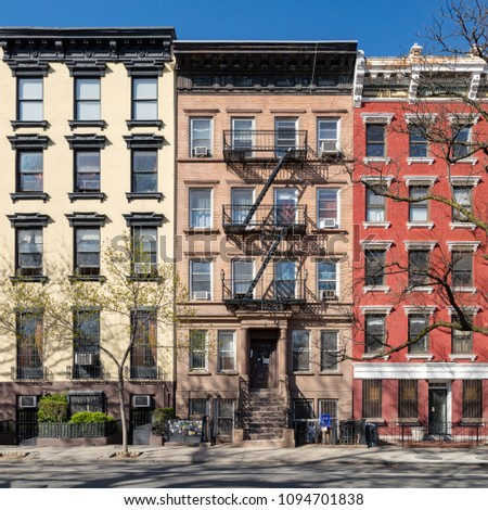 Colorful old buildings along Tompkins Square Park in the East Village of Manhattan in New York City NYC