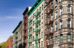 Colorful old historic buildings at the intersection of Mott and Kenmare Street in Nolita neighborhood of Manhattan, New York City