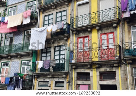Colorful old houses of Porto, Portugal with hanging clothes