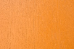 Colorful orange painted wood texture as background