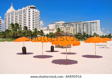 Colorful orange umbrellas in popular South Beach in Miami.
