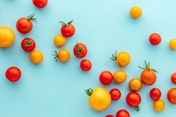 Colorful organic cherry tomatoes on a blue background, Marble Red and Golden Plum Holland cherry tomato