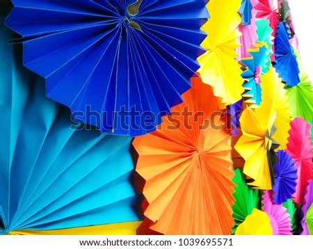 Stock Photo colorful origami fans wheel - paper decorations on the wall.