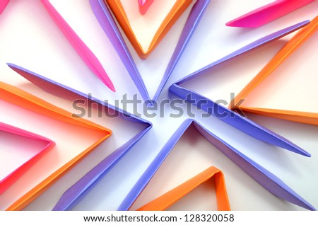 colorful origami pattern made of folding sheets of paper