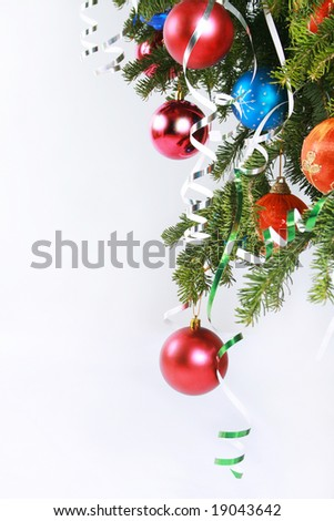 Colorful ornament hanging on Christmas tree