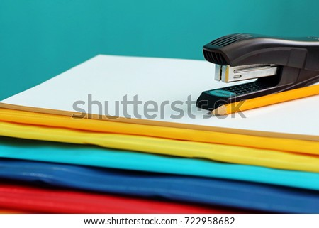 Colorful packaging, staplers and pencil in the office