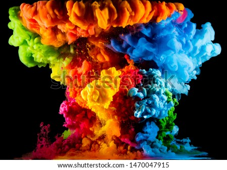 Colorful paint drops from above mixing in water. Ink swirling underwater #1470047915
