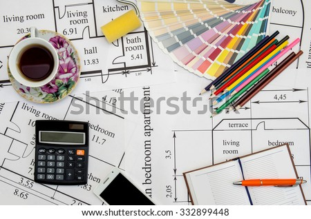 colorful paint samples on house plan  with pencil, notebook, tea as background