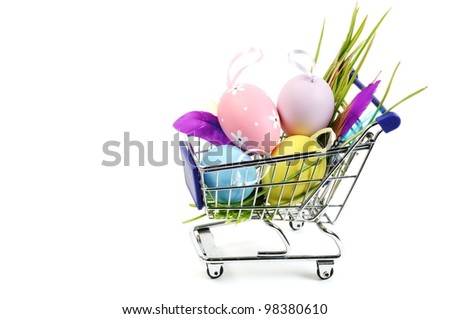 Colorful painted Easter eggs in a shopping cart, white background