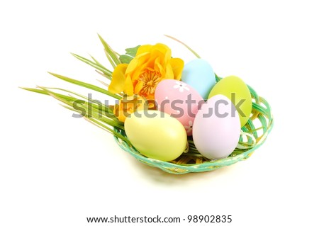 Colorful painted Easter eggs in a wooden plate, white background